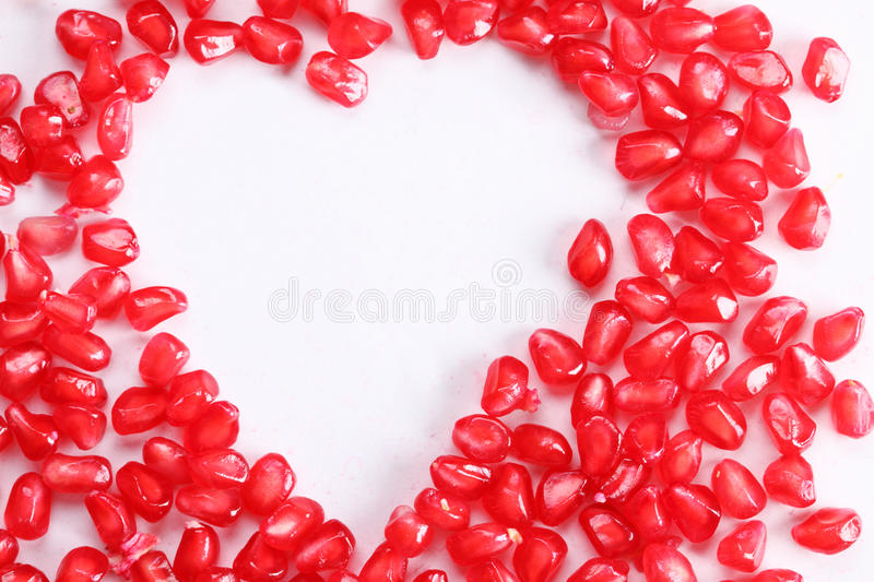 Heart shape of pomegranate seed royalty free stock image