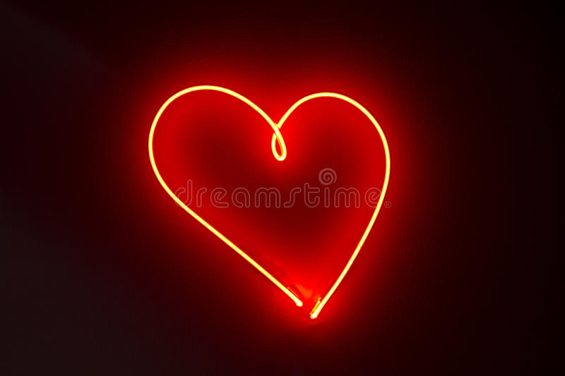 Heart shape red neon lights stock images