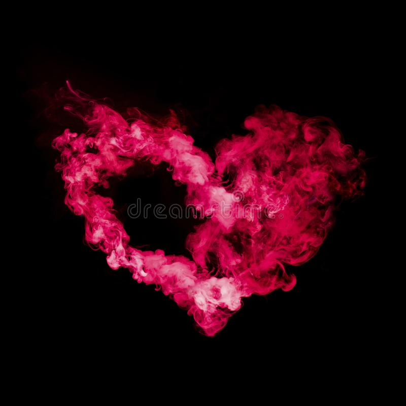 Heart shape from red smoke. Isolated on black background stock photo