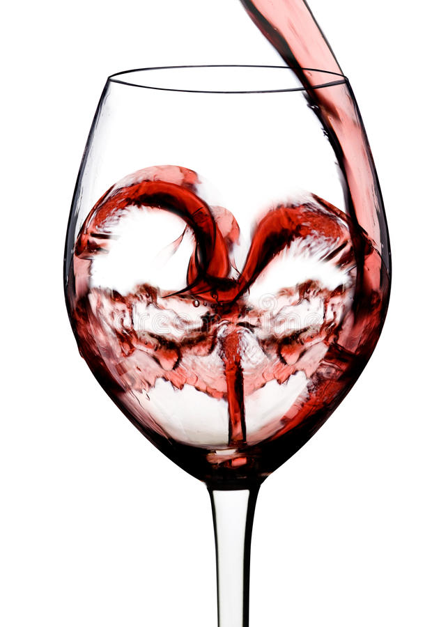 Heart shape from red wine. With white background royalty free stock photos