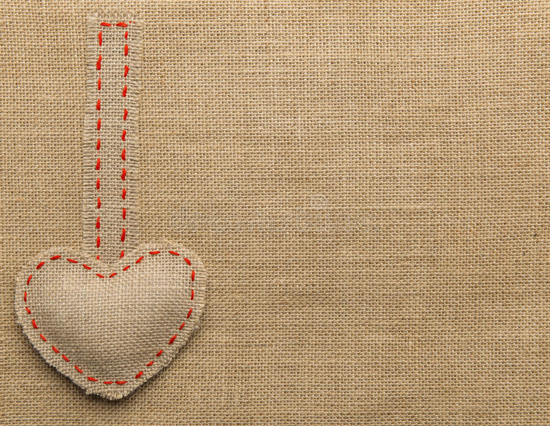 Heart Shape Sackcloth Sewing Object. Mended Burlap Background. Valentine Day Burlap or Wedding Love concept royalty free stock photos