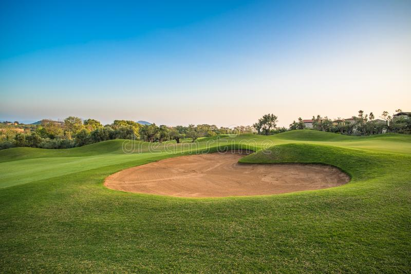 Heart shape sand bunker on the green golf course. royalty free stock photos