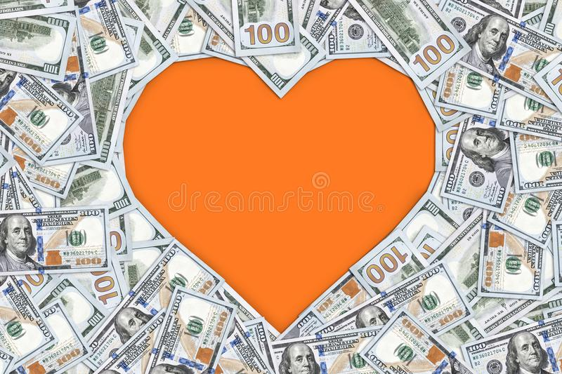 Heart shape sign with 100 dollar banknotes. Valentine concept background royalty free stock images