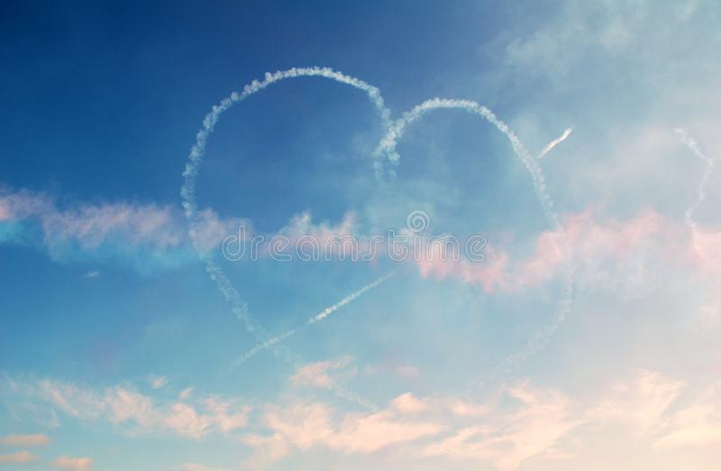 Heart shape smoke trails royalty free stock image