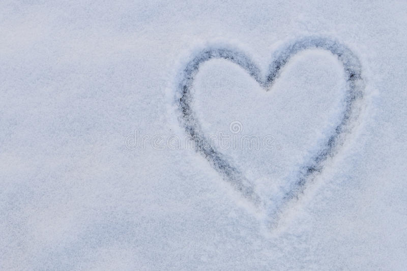 Heart shape on snow. Copy space royalty free stock photo