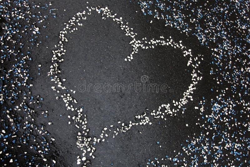 Heart shape on the tarmac. Heart created from pebbles on the tarmac royalty free stock photos