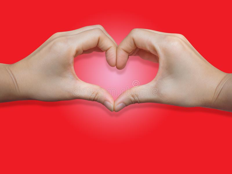 Heart shape from two hand put on red background royalty free stock image
