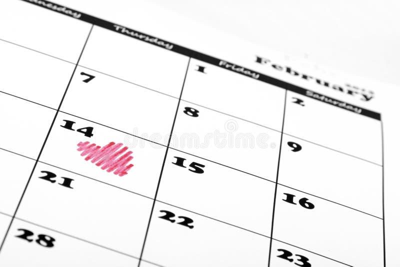 Heart shape on valentine day calendar royalty free stock photo