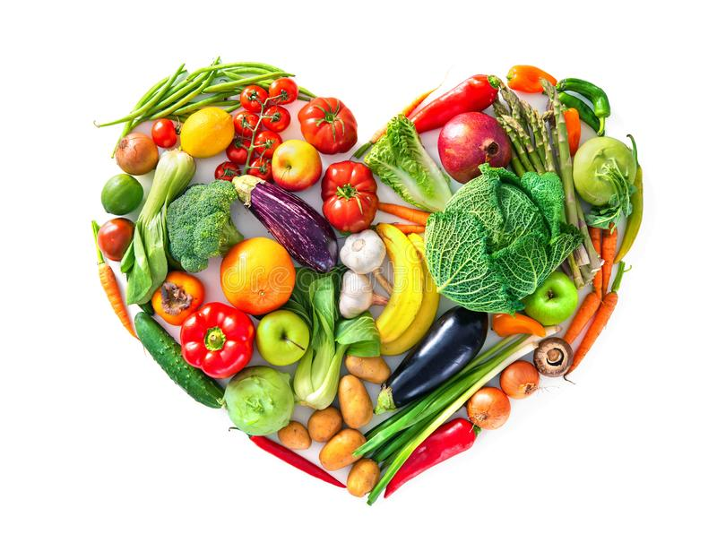 Heart shape by various vegetables and fruits. Healthy food concept royalty free stock photos