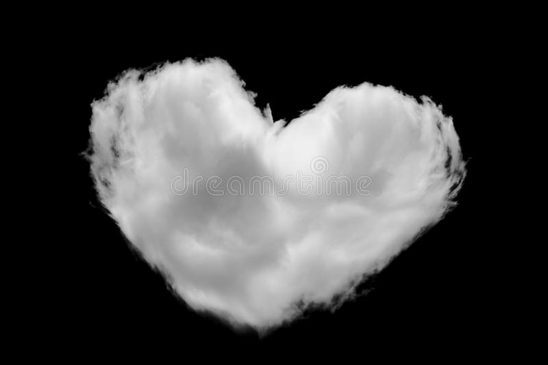 Heart shape of White fluffy clouds on the black sky background stock image