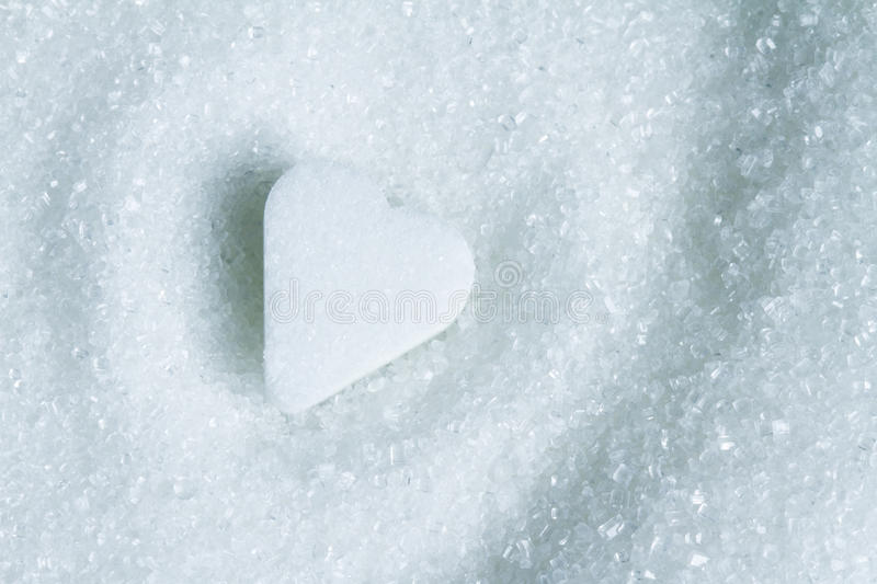 Heart shape on white sugar abstract stock photo
