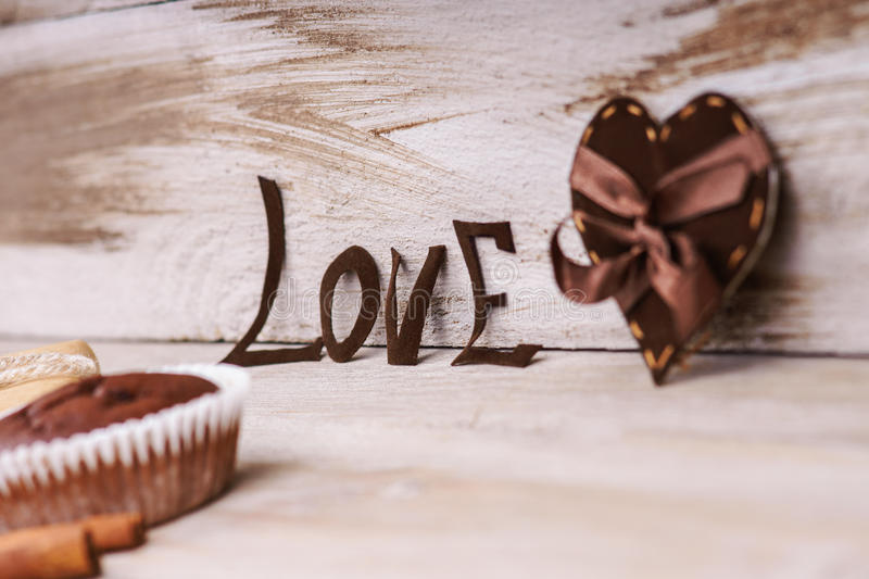 Heart shape, word love and chocolate muffin royalty free stock photo