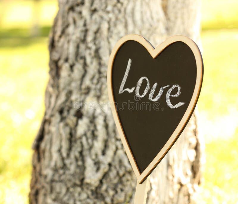 Heart-shaped blackboard as wedding outdoors stock image
