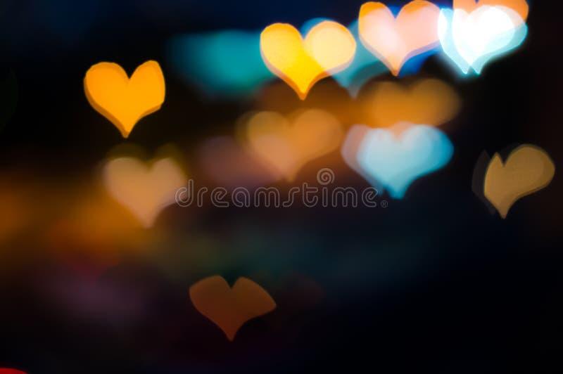 Heart shaped Bokeh pattern on dark background stock photo