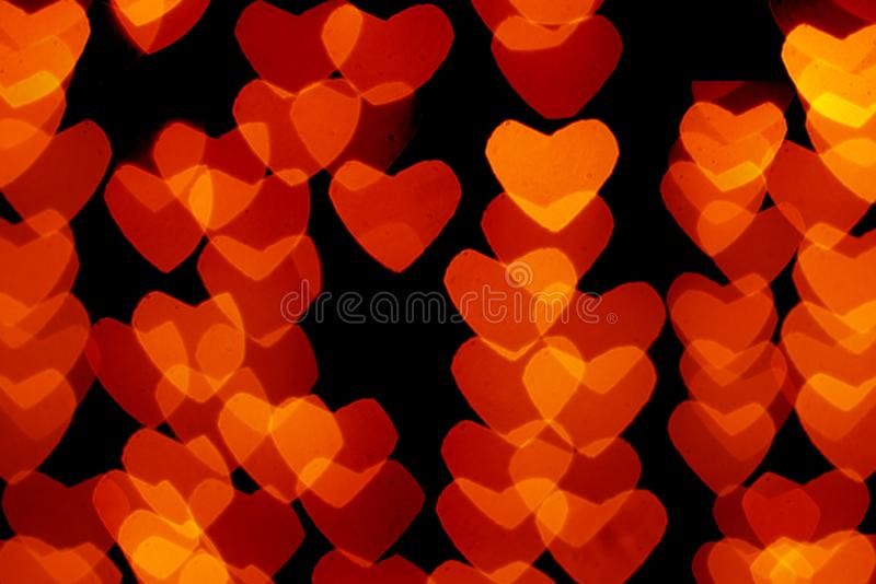 Heart shaped bokeh on black background royalty free stock images