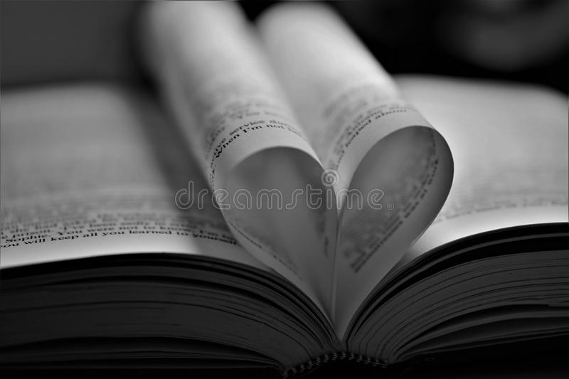 Heart shaped book's page. Heart shaped book page black and white stock image