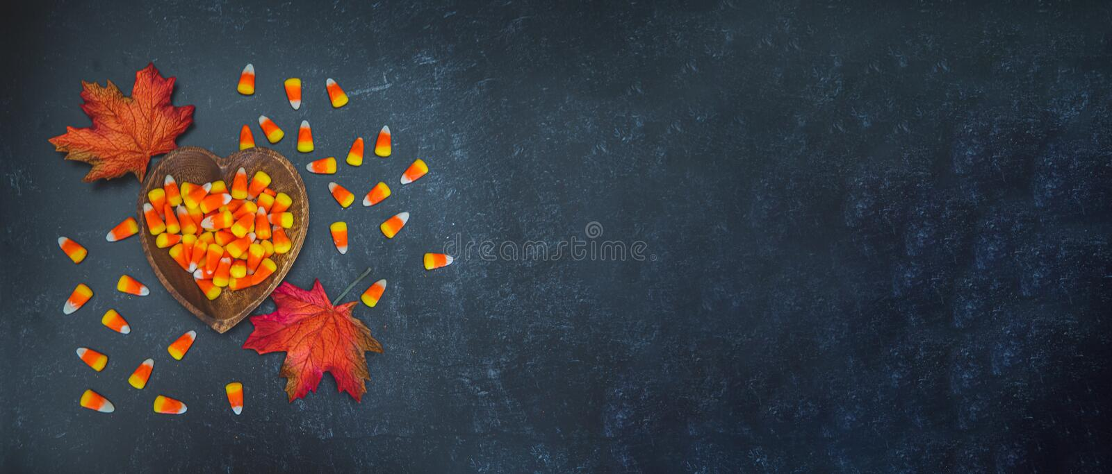 Heart shaped bowl of autumn fall halloween candy corn stock images