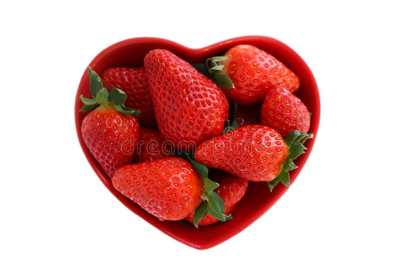 Heart shaped bowl with strawberry. royalty free stock photography