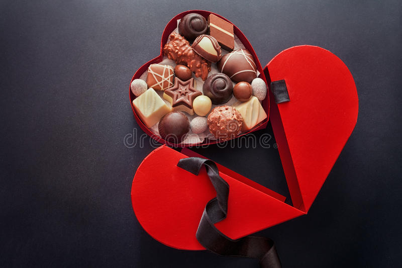 Heart shaped box of chocolate pralines, Valentines Day royalty free stock images