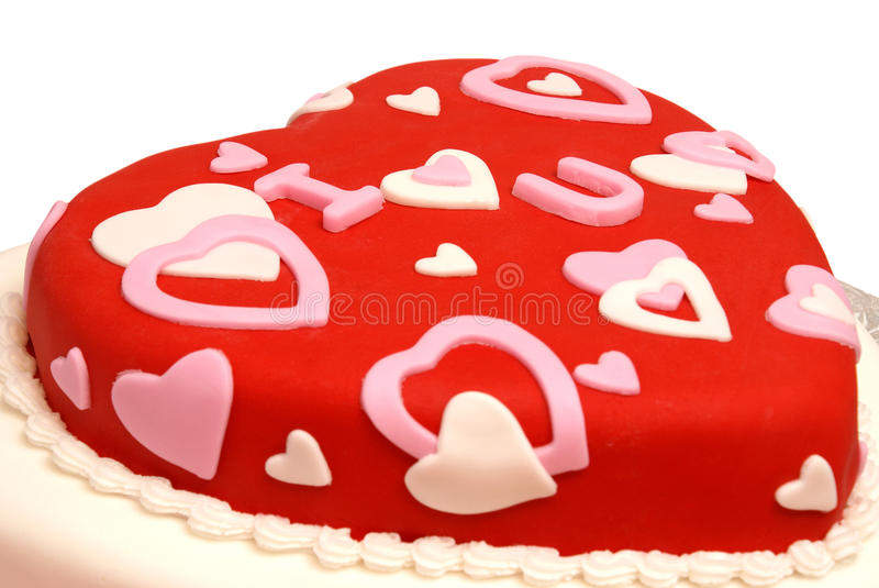 Heart Shaped Cake. A cake in the shape of a heart for Valentines, Anniversaries, and Birthdays stock photos