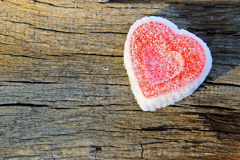Heart shaped cake on wooden background. Heart shaped cake on the wooden background royalty free stock photos