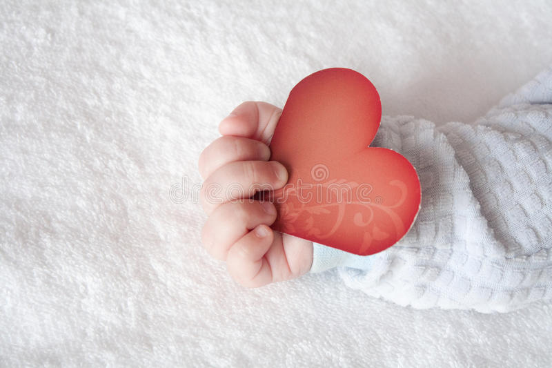 Heart Shaped Card In Baby Hand Stock Photo - Image of ...