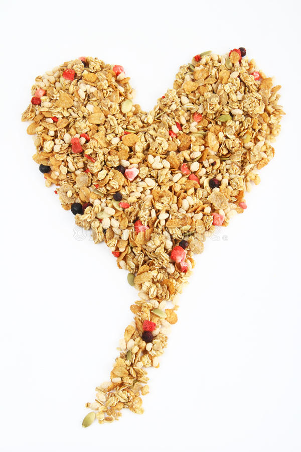 Heart shaped cereal. Healthy cereal in the shape of a heart on a white background royalty free stock photography