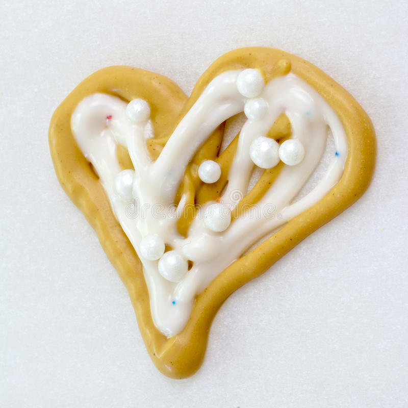 Heart Shaped child made candy on paper stock image