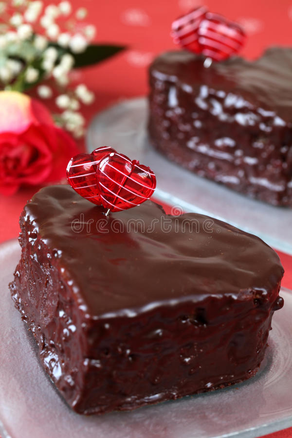 Heart shaped chocolate cakes and rose stock photos