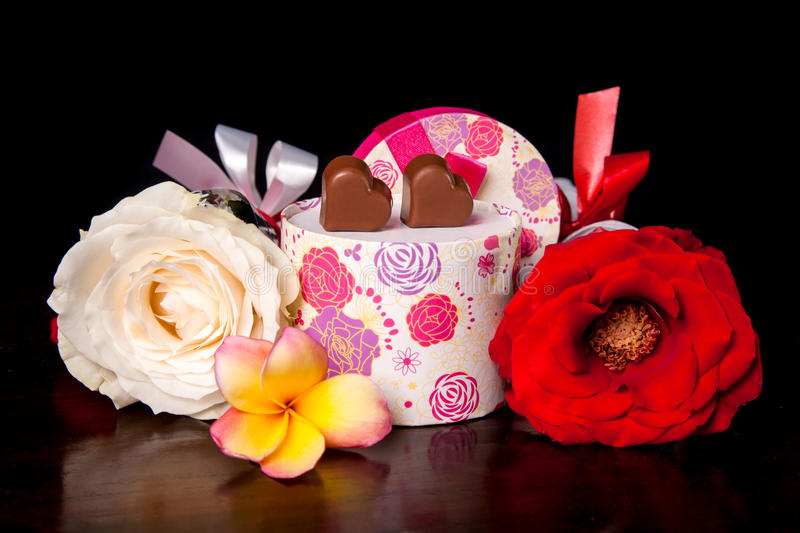 Heart Shaped Chocolate Love in rounded gift box with flower Valentines Day royalty free stock photography