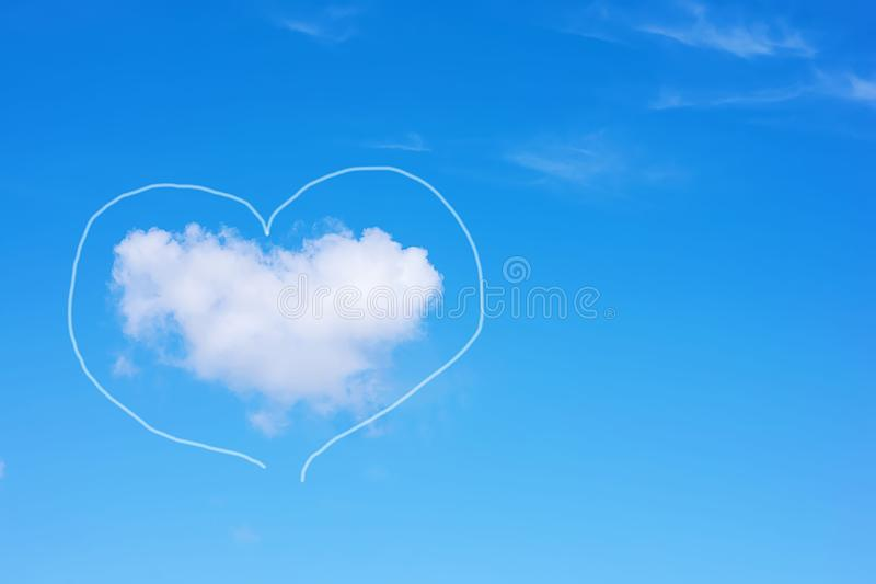 Heart-shaped cloud on a blue sky. Copy space. Concept of love, romance and valentines day.  royalty free stock image