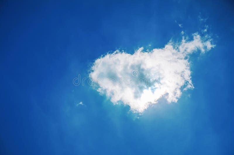 Heart shaped cloud in the blue sky. Heart shaped cloud in the deep blue sky royalty free stock image