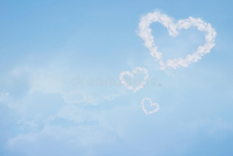 Heart shaped cloud in blue sky. Valentine and wedding background royalty free stock photography