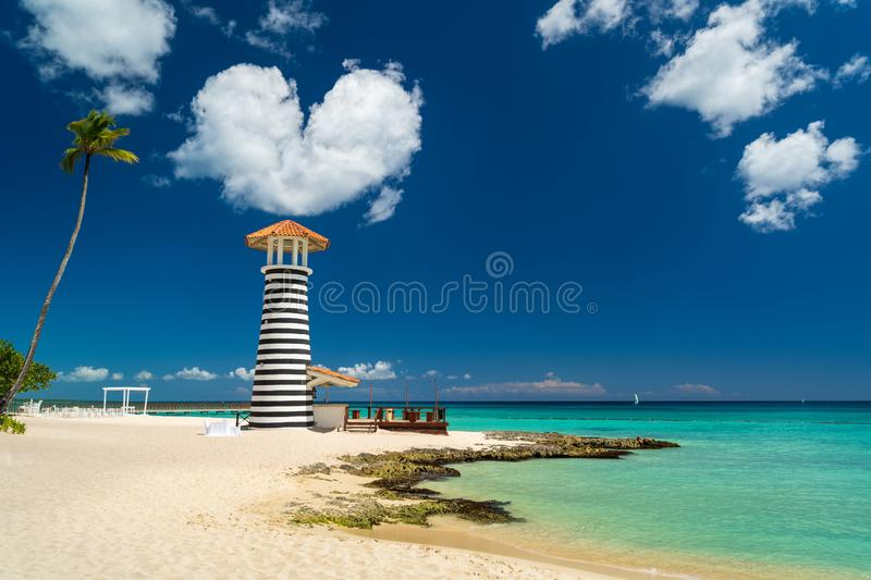 Heart shaped cloud over Lighthouse on the beach of the Caribbean, Dominican Republic, Bayahibe - Love Wedding Concept royalty free stock photography
