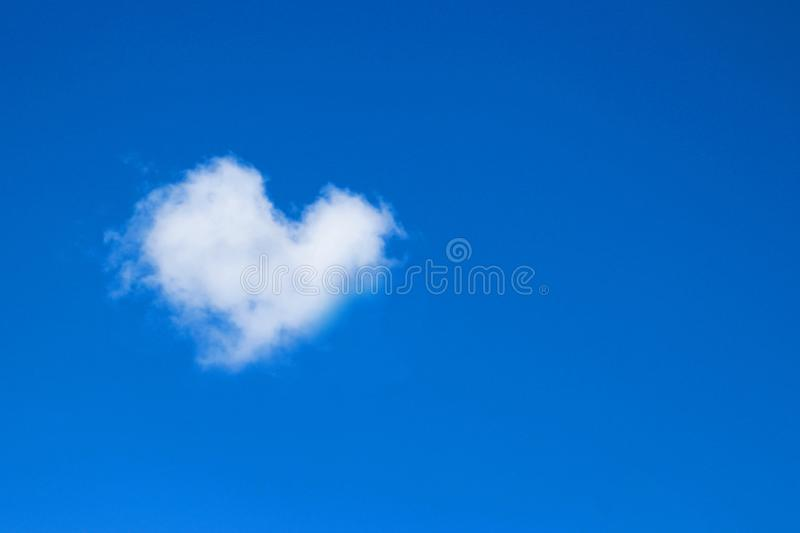 Heart shaped clouds on blue sky. Love concept royalty free stock photo