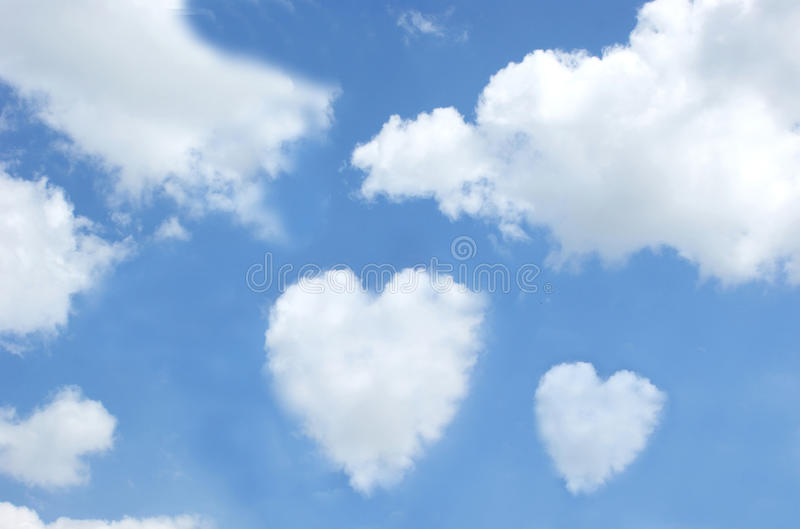 Heart shaped clouds in the sky stock image