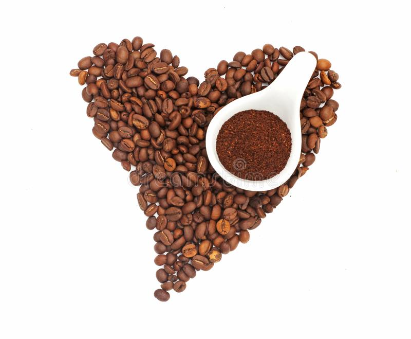 Heart-shaped coffee beans with crushed coffee beans on white background, illustration.  stock photo
