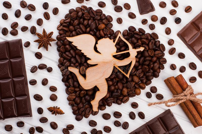 Heart shaped coffee beans and cupid with arrow. royalty free stock images