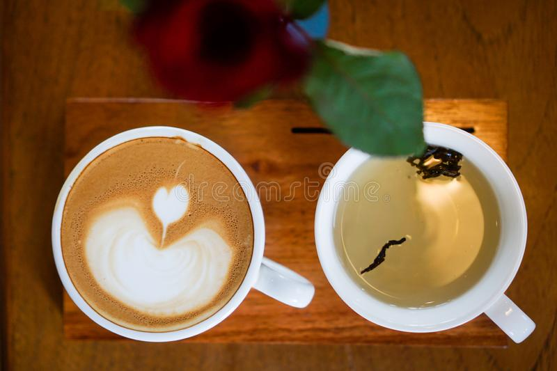 Heart-shaped coffee on a brown wood table.  royalty free stock photography