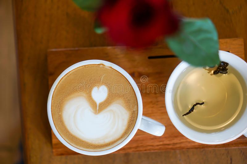 Heart-shaped coffee on a brown wood table.  royalty free stock image
