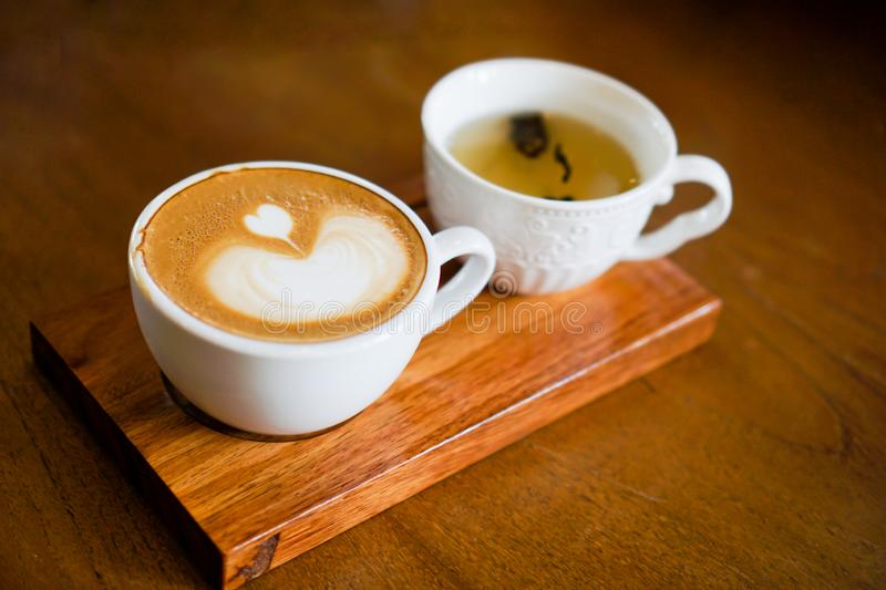 Heart-shaped coffee on a brown wood table.  royalty free stock images