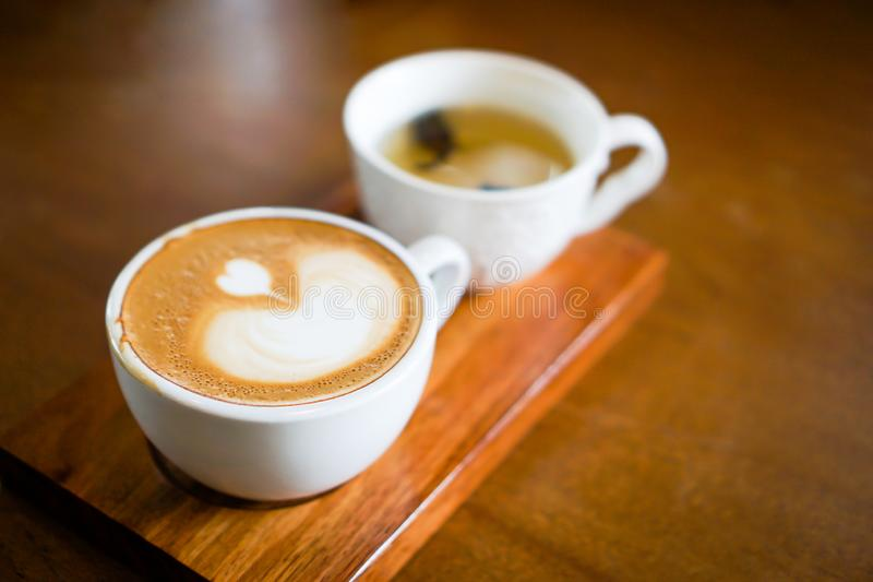 Heart-shaped coffee on a brown wood table.  stock image