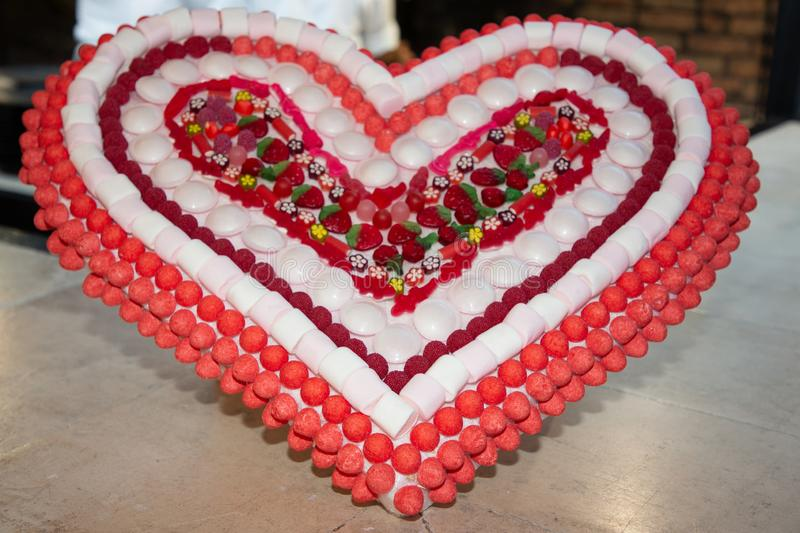 Heart shaped collection of red pink candies candy arranged as heart for Valentine Day stock photography