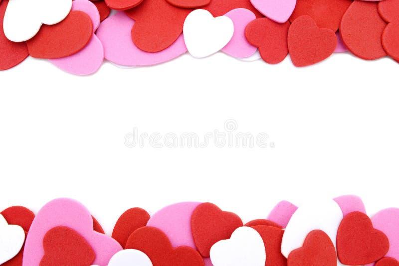 Heart-shaped confetti border royalty free stock image