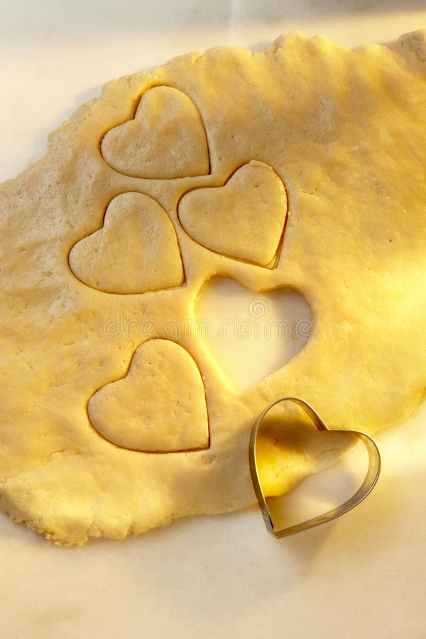 Heart shaped cookie cutter with dough royalty free stock images