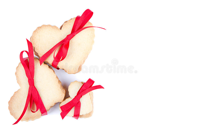Heart shaped cookie tied with ribbon stock photography