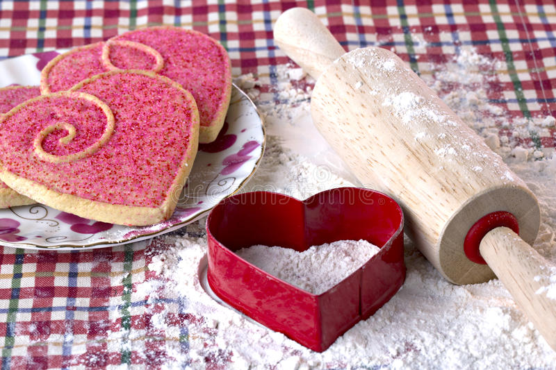 Heart shaped cookies, cutter and wooden rolling pin