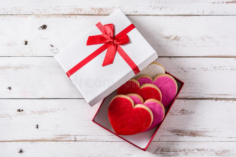 Heart-shaped cookies in gift box for Valentine`s Day stock photos