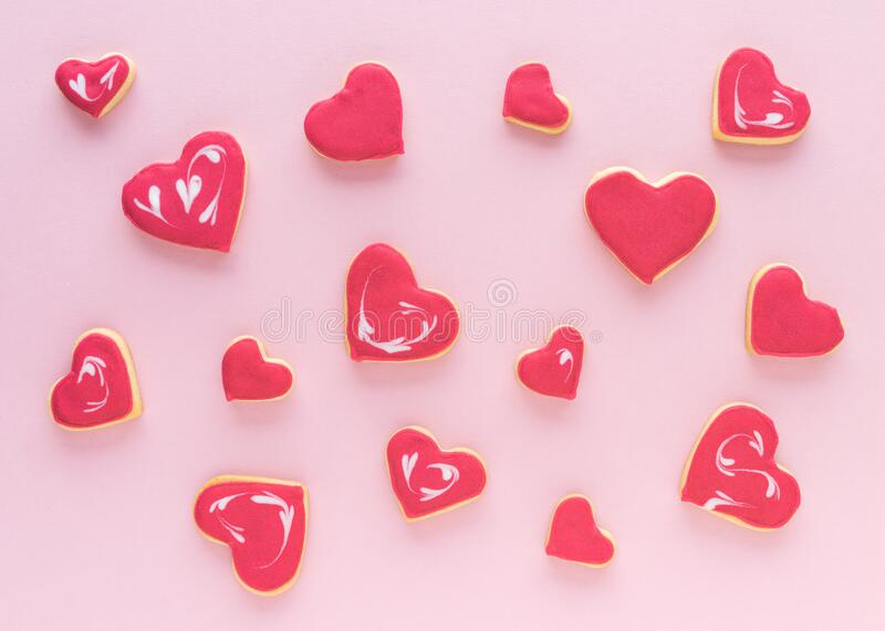 Heart shaped cookies on a pink background. Flat lay. Valentine`s Day concept stock photo