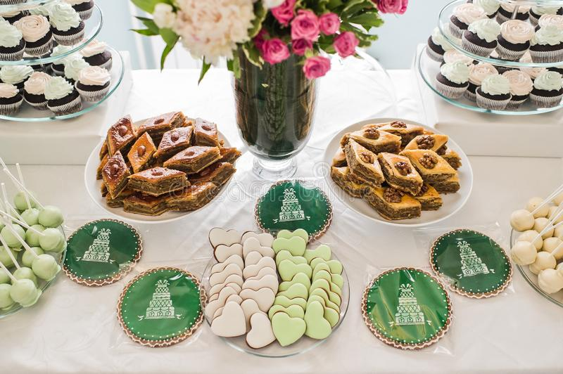 Heart-shaped cookies pink and green, sweet table in the restaurant. royalty free stock photos